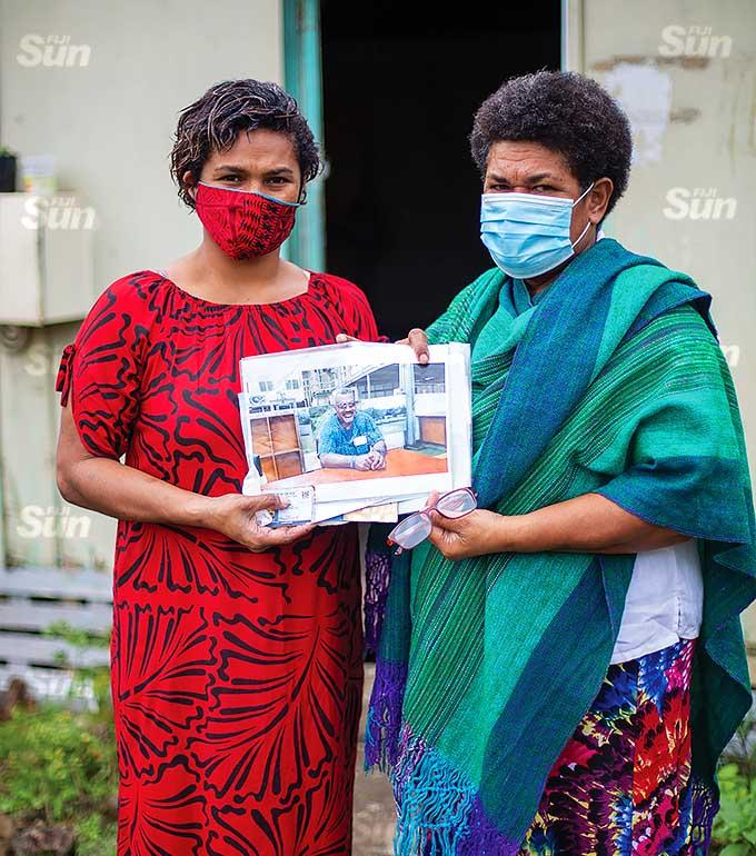 Rajeli Tuinavitilevu and her mother Rasala Kaubale hold a picture of the late Adriu Kaubale. Photo: Leon Lord