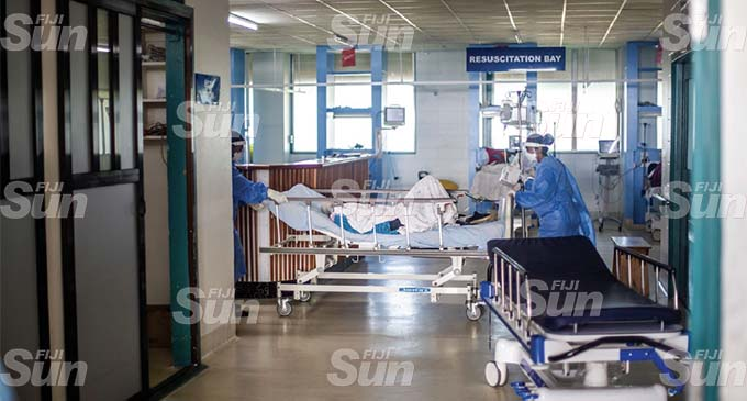 Frontline health workers attend to another patients at the Colonial War Memorial Hospital in Suva on July 22, 2021. Photo: Leon Lord