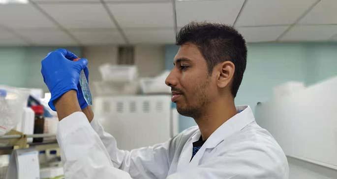 Ashmit Kumar working in the lab.