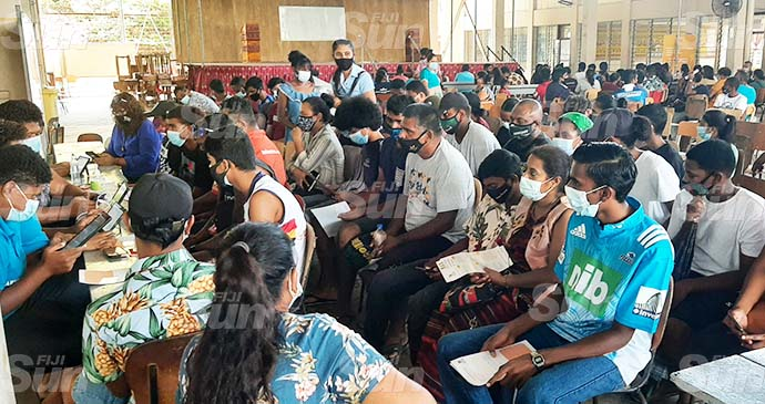 Parents wait with their children at the registration area in Tilak High School, Lautoka on September 20, 2021. Photo: Salote Qalubau