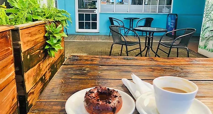 Donut and a cup of coffee at Vanua Chocolate in Nadi.