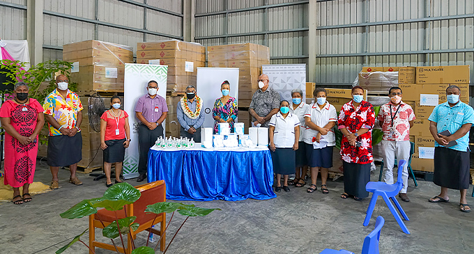 Guests and staff of Katalyst Foundation at the handover of PPE ceremony at their Kalabu tax free zone warehouse in Nasinu today.