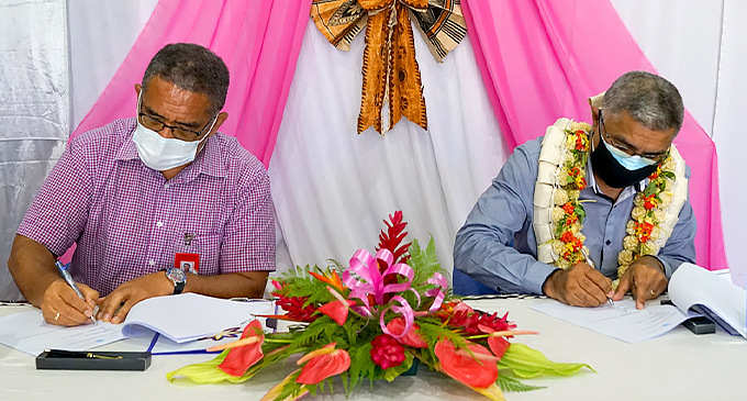 Katalyst Trustee Rokoseru Nabalarua and Permanent Secretary for Health & Medical Services, Dr James Fong sign the handover of $500,000 worth of personal protection equipment.
