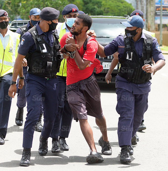 One of the youths who was part of the large crowd that gathered outside Nasova in Suva on October 7, 2021, was detained by police officers for causing a commotion. Police spokesperson Ana Naisoro said the youth was released without charge. Photo: Ronald Kumar