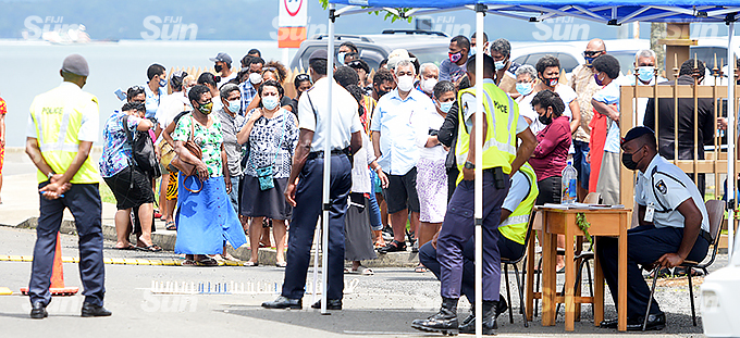 Police officers monitor the large crowd outside Nasova Police Academy as 45 accuse from Nabua brawl appeared in a special Court in Nasova on 7, October 2021. Photo: Ronald Kumar.