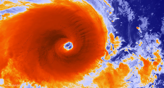 Tropical Cyclone Winston sprawled across the Fiji Islands on February 20, 2016. This infrared view of the storm from the NOAA-NASA Suomi satellite shows warm surfaces (such as the open ocean at image upper right) in shades of blue with progressively colder temperatures (such as the tops of Winston's towering thunderstorm clouds) in darkest red. Image by Dan Pisut, NOAA Environmental Visualization Lab.